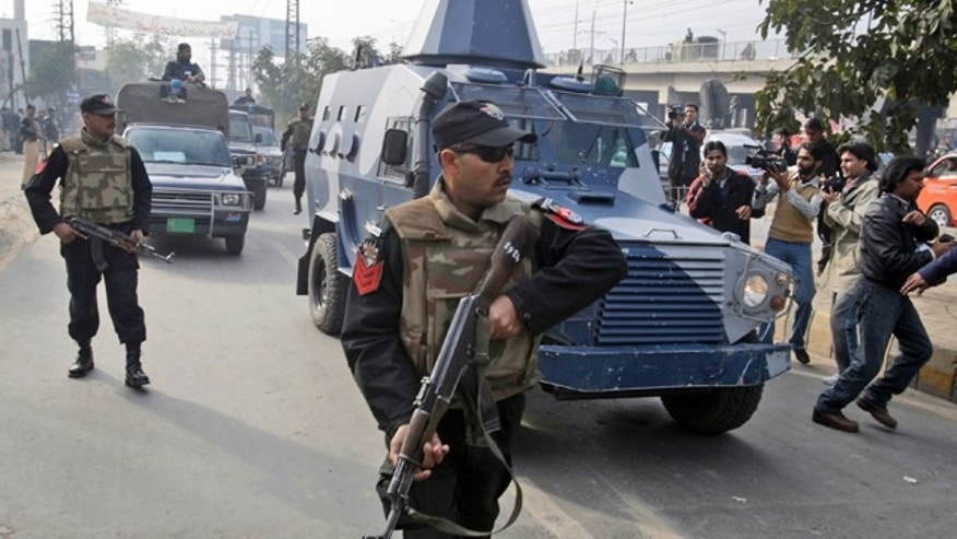 Feb. 11, 2011: An armored car carrying Raymond Allen Davis, a U.S. consulate employee suspected in a shooting, leaves a court in Lahore, Pakistan