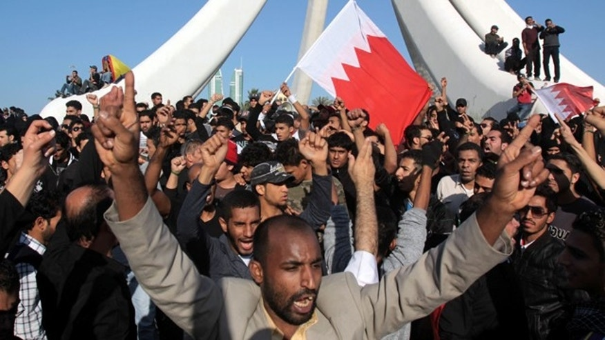 Feb. 15: Demonstrators chant and wave Bahraini flags near the Pearl Monument on a main square in Manama, Bahrain.
