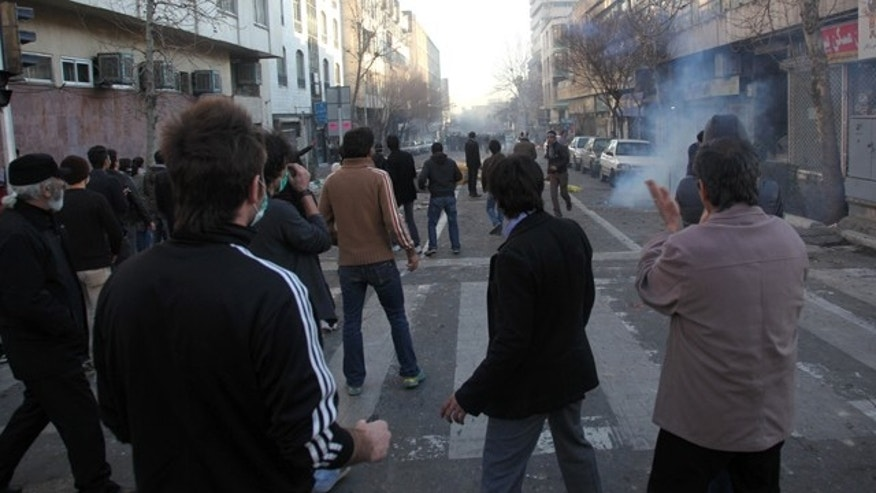 Feb. 14: Iranian protestors attend an anti-government protest in Tehran, Iran.  (This photo was  taken by an individual not employed by the Associated Press and obtained by the AP.)