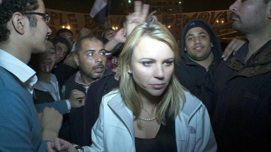 Feb. 11: CBS Correspondent Lara Logan is pictured in Cairo's Tahrir Square moments before she was assaulted.