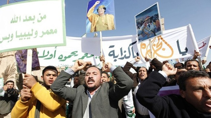 Feb. 17: Pro-government supporters chant slogans during a demonstration in Tripoli.