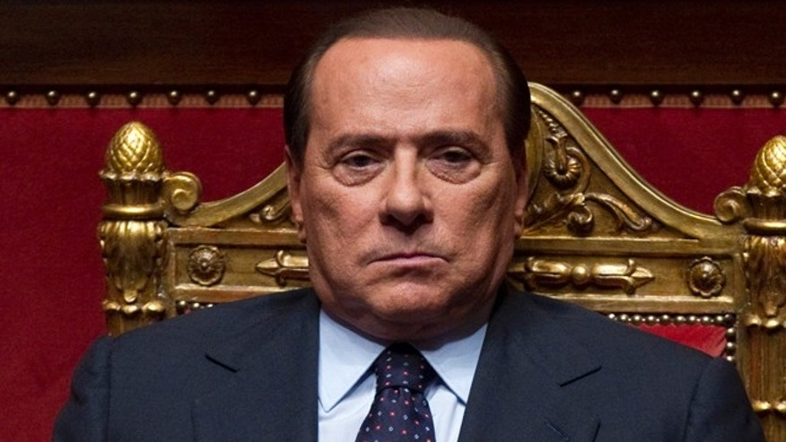 In this photo taken on Sept. 30, 2010, Italian Premier Silvio Berlusconi looks on at the Senate, in Rome.
