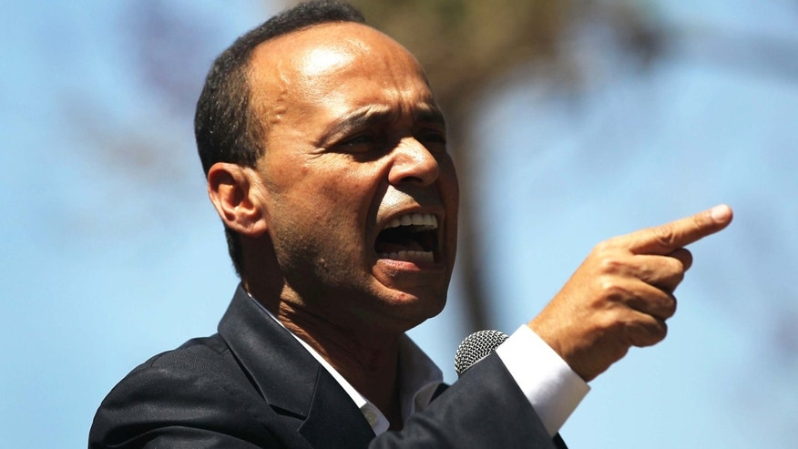 PHOENIX - APRIL 25:  U.S. Rep. Luis Gutierrez (D-IL), speaks in favor of national immigration reform at a rally on April 25, 2010 in Phoenix, Arizona. A large crowd gathered to protest the passage of Arizona's tough new immigration enforcement law which was signed by the state's Republican governor Jan Brewer two days before. Critics of the law say that it will encourage racial profiling by law enforcement and endanger the civil rights.  (Photo by John Moore/Getty Images)