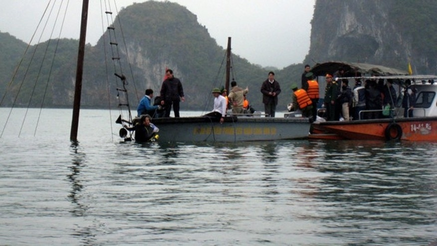 Feb. 17: Vietnamese rescuers search for victims of a sunken tourist boat whose sail pole still emerged from water on Ha Long Bay in northern Quang Ninh province, Vietnam.