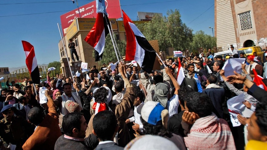 Feb. 17: Supporters of the Yemeni government gather as they wave flags and chant slogans, in Sanaa, Yemen. For seven straight days, protests have hit the capital, Sanaa, and other cities in the Arab world's poorest country, a mountainous territory wracked by tribal conflicts, armed rebellion and other serious woes.