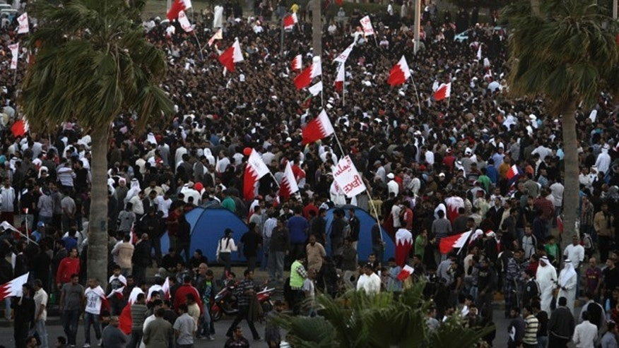 Feb. 19: Bahraini protesters celebrate at the Pearl roundabout after the military pulled out in Manama, Bahrain.