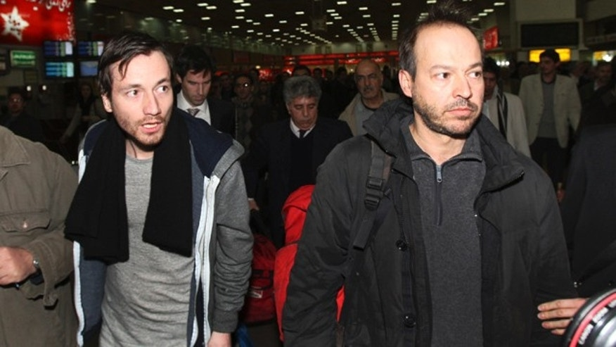 Feb. 19: German journalists Jens Koch, left, and Marcus Hellwig, arrive at the Mehrabad airport in Tehran, Iran, from the northwestern city of Tabriz where they have been jailed.