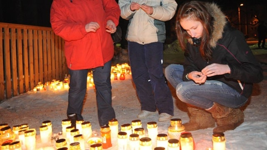 Feb. 20, 2011: People light candles in memory of children who died after fire raced through an orphanage for disabled children in Haapsalu, western Estonia.