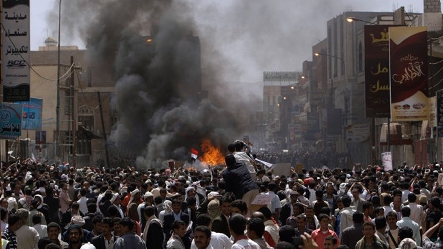 Feb. 22, 2011: Yemeni anti-government demonstrators gather during during clashes with supporters of President Ali Abdullah Saleh, in Sanaa, Yemen. Yemen's embattled leader rejects demands that he step down, calling demonstrations against his regime unacceptable acts of provocation and offers to begin a dialogue with protesters.