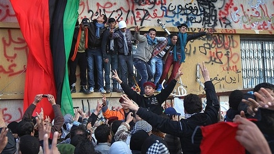 Feb. 26: People cheer during a celebration of the 'liberation' of eastern Libya in Benghzai.