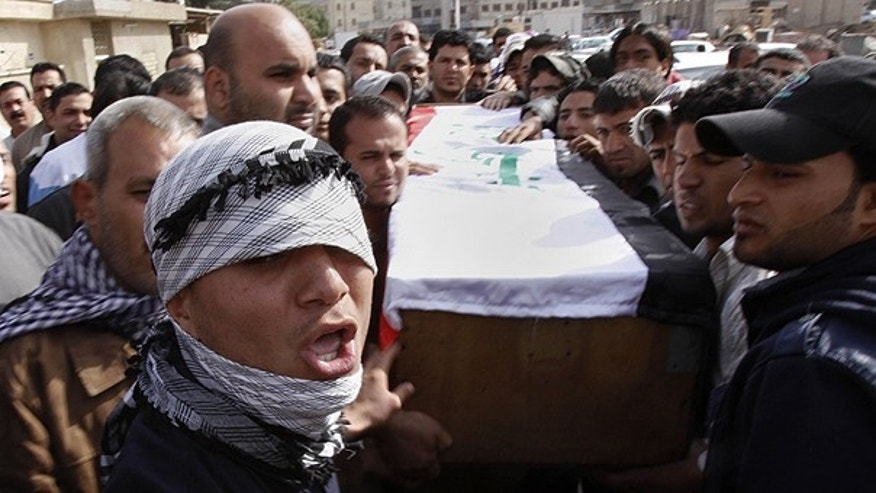 Feb. 26: Relatives of Salim Farooq, 18, carry his coffin during his funeral procession in Basra, Iraq's second-largest city, Iraq. Farooq was killed on Friday during a demonstration in Basra, his family said.