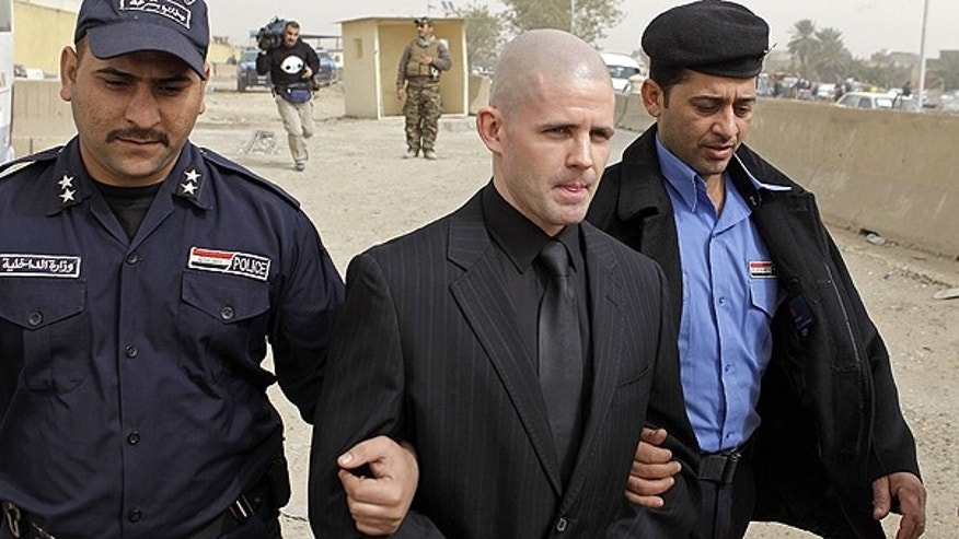 Feb. 20: Danny Fitzsimons, center, walks out of a court in Baghdad.