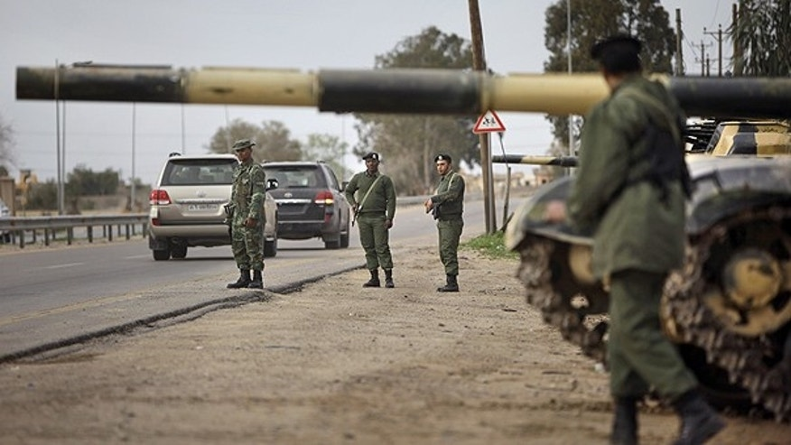 Feb. 28: Soldiers and dozens of tanks from the Libyan military's elite Khamis Brigade, led by Qaddafi youngest son Khamis Qaddafi take positions and check vehicles after arriving hours earlier on the road in Harshan, 10km east of Zawiya, in Libya.