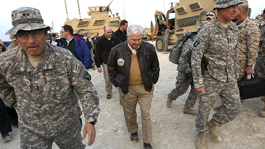 In this Dec. 7, 2010 file photo, Defense Secretary Robert Gates walks with Maj. Gen. John Campbell, left,, commanding general of the 101st Air Assault, in Kunar Province, Afghanistan.