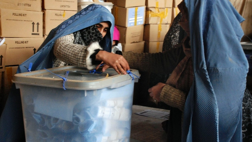 Feb. 28: Afghan election workers open a ballot box from September's parliamentary election to be recounted at the main election office in Herat, Afghanistan. Election officials say vote recounts that could throw doubt on the legitimacy of Afghanistan's parliament are underway in 10 provinces, even as the legislature starts work with its newly elected speaker.
