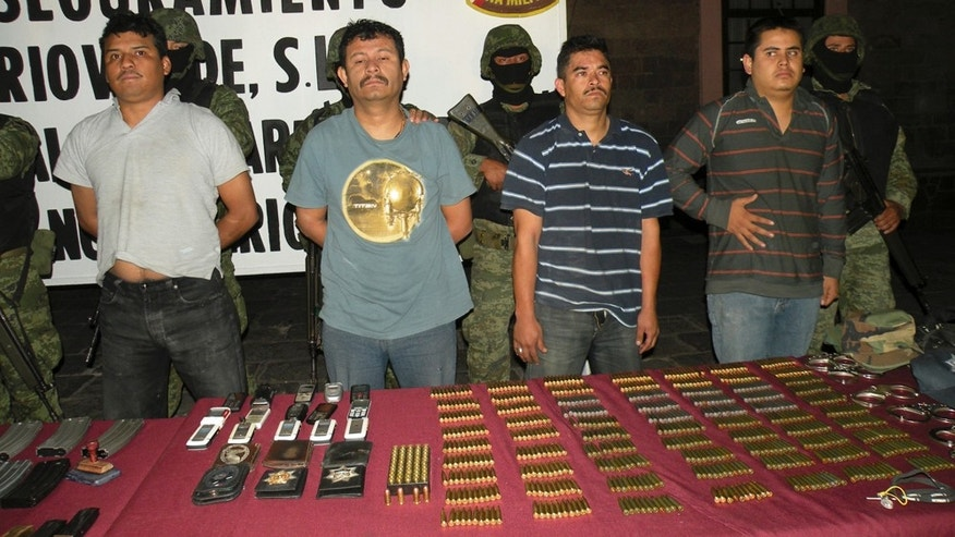 "In this Dec. 11, 2009 photo obtained by the Associated Press on Wednesday Feb. 23, 2011, suspects are shown to the press at the 12th Military Zone in San Luis Potosi, Mexico. Among the suspects is Julian Zapata Espinoza aka ""El Piolín"" , third from left. Zapata Espinoza was again shown to the press on Feb. 23, 2011 after his arrest for allegedly being the main suspect in the Feb. 15 killing of U.S. Immigration and Customs, ICE, agent Jaime Zapata and injuring ICE agent Victor Avila. The Mexican Attorney General's Office confirms that Zapata Espinoza had been arrested on unspecified federal charges in 2009, but jumped bail and disappeared until he was re-arrested Wednesday. (AP Photo)"