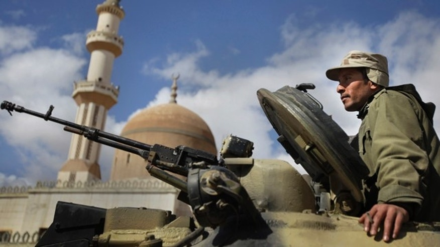 March 1: A pro-Qaddafi Libyan soldier sits in an armoured vehicle next to a mosque in Qasr Banashir, southeast of the capital Tripoli, in Libya.