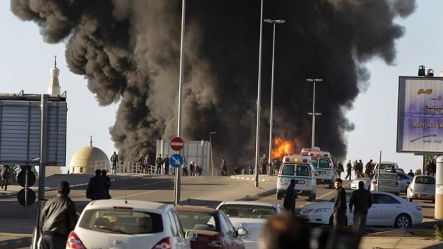 March 2: Emergency services attend to the scene of a fuel-tanker explosion, which security forces at the scene said was due to a road accident, in Tripoli, Libya.