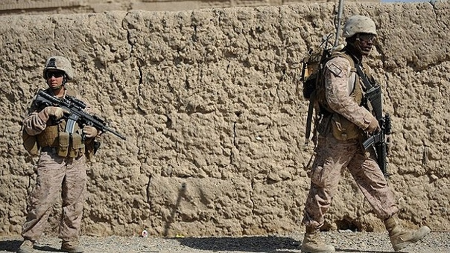 Feb. 23: Soldiers from the U.S. Marines 2nd Batallion, 1st Marines Regiment patrol in Garmser, Helmand province, Southern Afghanistan.