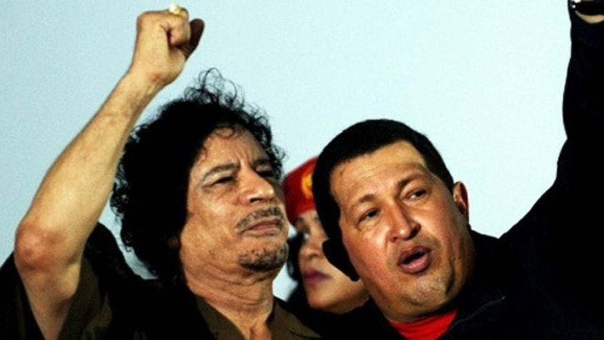 Libyan leader Muammar al-Qaddafi and Venezuelan President Hugo Chavez greet sympathizers in Porlamar, Margarita Island, in northwestern Venezuela, on September 28, 2009.