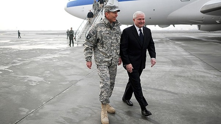 March 7: Defense Secretary Robert M. Gates, right, walks with Gen. David Petreaus upon his arrival in Kabul, Afghanistan.