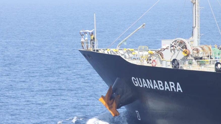 March 6: Suspected pirates indicate their surrender on the bow of Japanese-owned commercial oil tanker M/V Guanabara. Combined Maritime Forces warship USS Bulkeley, with support from Turkish warship TCG Giresun of NATO's counter-piracy Task Force 508, responded to the reported pirating of Guanabara, which resulted in the detention of the four suspected pirates and freeing of 24 crew members. (U.S. Navy)