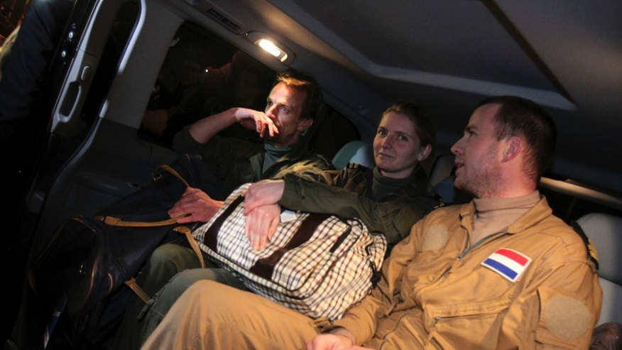 March 11: Three Dutch marines who were captured after a botched evacuation mission in Libya last month sit in a vehicle in Sparta, Greece. The marines arrived on Greek military transport at Athens' airport after being freed under a deal reached with the Libyan government, the Greek Foreign Ministry said.