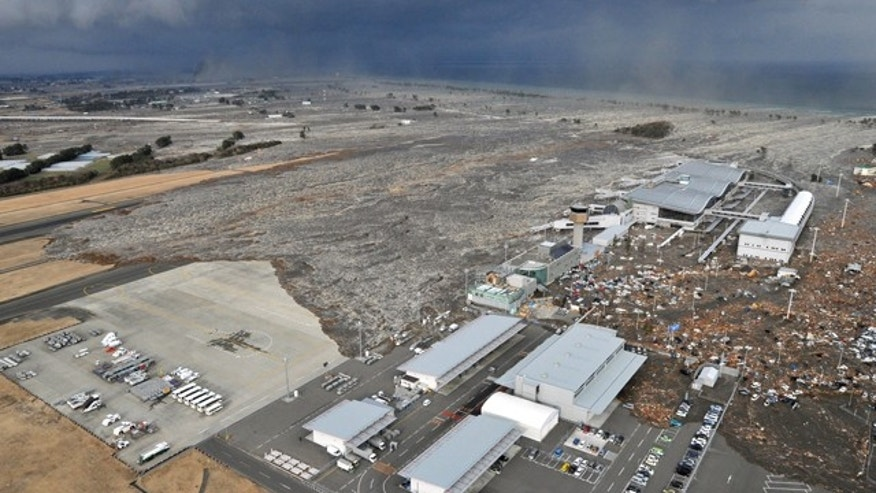 March 11: A tsumani triggered by a powerful earthquake makes its way to sweep part of Sendai airport in northern Japan. The magnitude 8.9 earthquake slammed Japan's eastern coast Friday, unleashing a 13-foot tsunami that swept boats, cars, buildings and tons of debris miles inland.