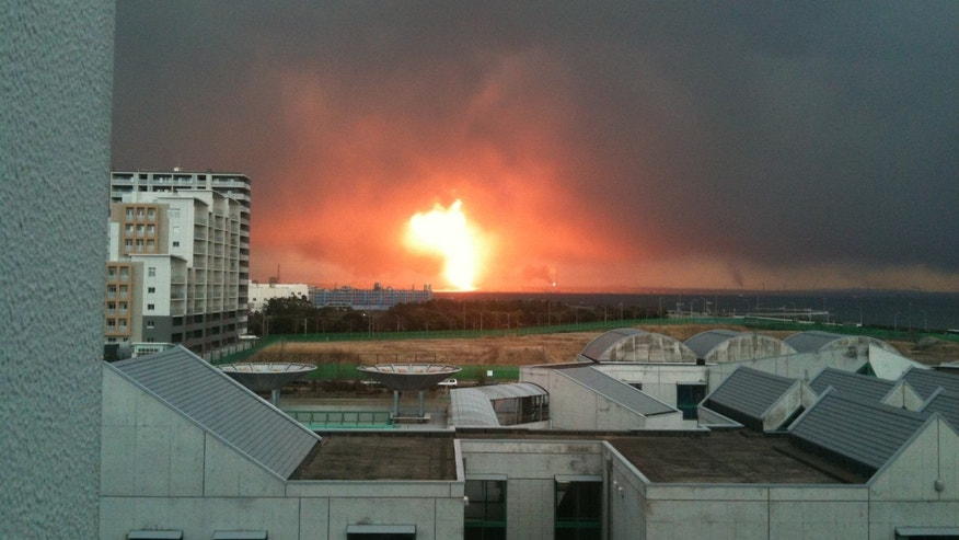 View from Christian Storms' window in Chiba City, Japan of the Cosmo Oil refinery explosion.