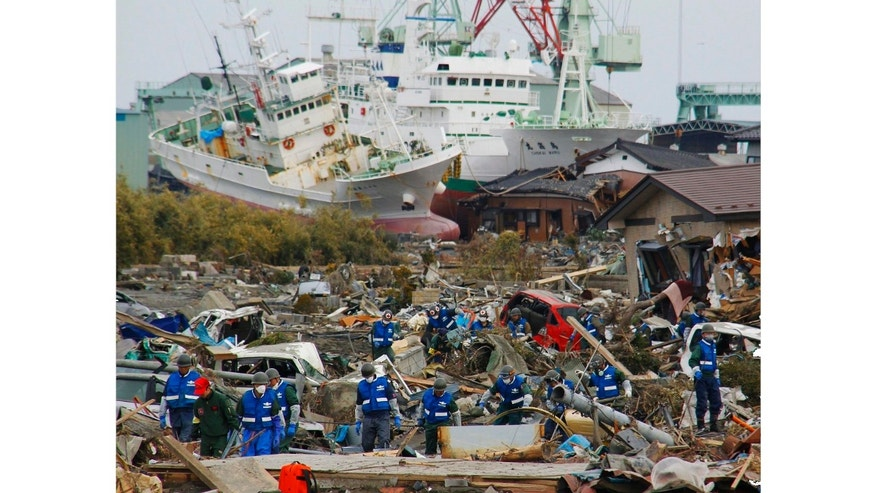 Soldiers of Japan Self-Defense Force and firefighters search for the victims in the rubbles Monday, March 14, 2011 in Matsushima, Miyagi Prefecture, Japan, three days after northeastern coastal towns were devastated by an earthquake and tsunami. (AP Photo/Kyodo News) JAPAN OUT, MANDATORY CREDIT, NO SALES IN CHINA, HONG KONG, JAPAN, SOUTH KOREA AND FRANCE