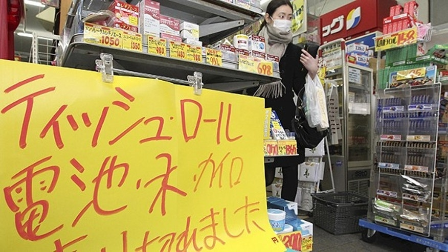 March 14: A notice is posted at a drug store in Mitaka, on the outskirts of Tokyo following Friday's massive earthquake and the ensuing tsunami. The sign reads, 'Tissue, battery, water and pocket warmer are sold out.'