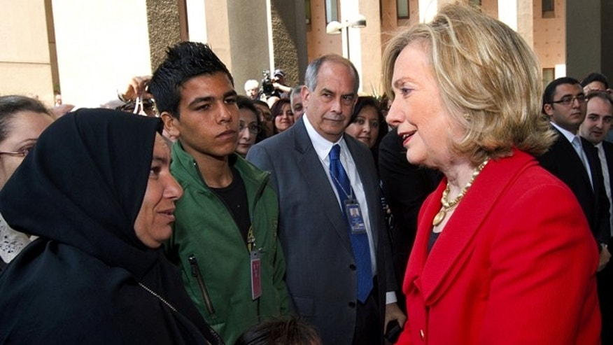 March 16: Secretary of State Hillary Rodham Clinton toured Cairo's Tahrir Square, the epicenter of the popular uprising that toppled Egypt's longtime autocratic leader. Here, she greets the family of Khairy Ramadan Ali, who was killed on in the anti-government protests.
