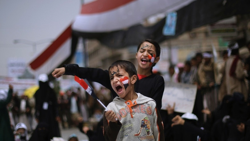 March 16: Yemeni children shout slogans along with anti-government protesters during a demonstration demanding the resignation of Yemeni President Ali Abdullah Saleh, in Sanaa, Yemen. Witnesses said government supporters wielding sticks, knives and guns attacked opposition protesters camped out at a main square in a southern Yemeni port, injuring hundreds, according to the Associated Press.