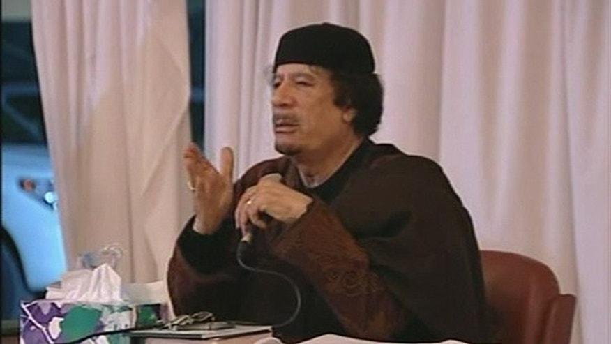 March 15: his image taken from Libya State TV, broadcast shows Libyan leader Moammar Gadhafi, as he faces a jubilant crowd, as shown on state TV.