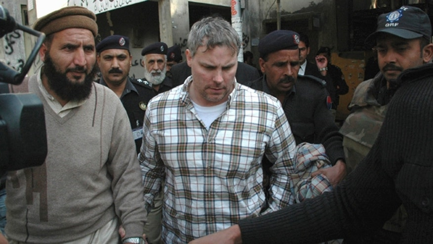 Jan. 28: Pakistani security officials escort a U.S. consulate employee, identified as Raymond Davis, to a local court in Lahore, Pakistan. Colorado authorities say Davis, accused of shooting and killing two men while working as CIA contractor in Pakistan, faces misdemeanor charges after a fight Saturday, Oct. 1, 2011, over a shopping center parking spot in Highlands Ranch, Colo.