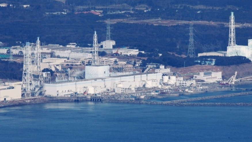March 17, 2011: Fukushima Dai-ichi nuclear power plant is pictured before helicopters dump water on the stricken reactor to cool overheated fuel rods inside the core in Okumamachi, Fukushima Prefecture, Japan.