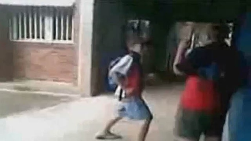 Footage of the fight shows seventh-grader Ritchard Gale, left, repeatedly tormenting, shoving and punching 10th-grader Casey Heynes at Chifley College in St. Marys North before the much-larger Heynes body slams Gale and walks away. (YouTube)