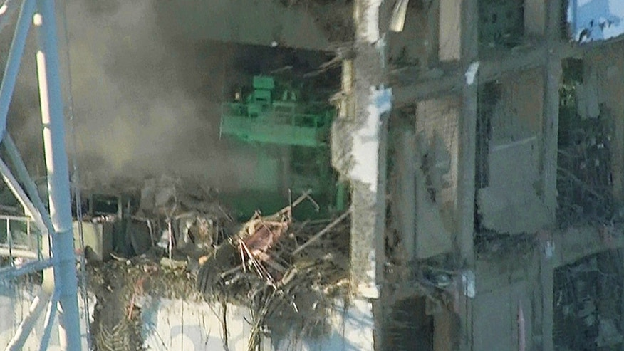 In this photo released on March 16, 2011, by Tokyo Electric Power Co., the top part of the badly damaged No. 4 unit of the Fukushima Dai-ichi nuclear power plant, is shown.