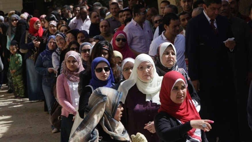 March 19, 2011: Hundreds of Egyptians line out a polling station in Cairo, Egypt as they prepare to vote on a referendum on constitutional amendments.