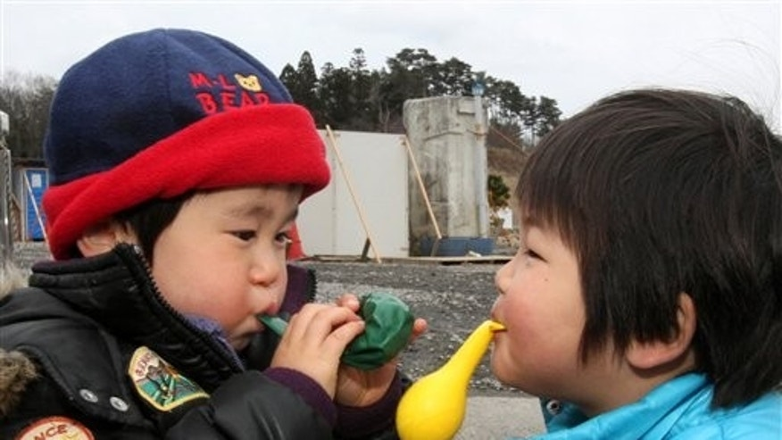 March 21, 2011: Children play with balloons at a shelter in the March 11 earthquake and tsunami-destroyed town of Minamisanriku, northern Japan.