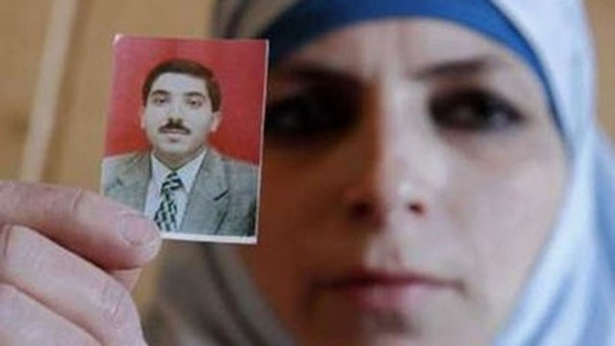 March 11, 2011: Veronica, wife of Dirar Abu Sisi, a Palestinian who disappeared last month in Ukraine, holds up her husband's photo during a meeting with journalists at the Islamic Centre in Kiev.