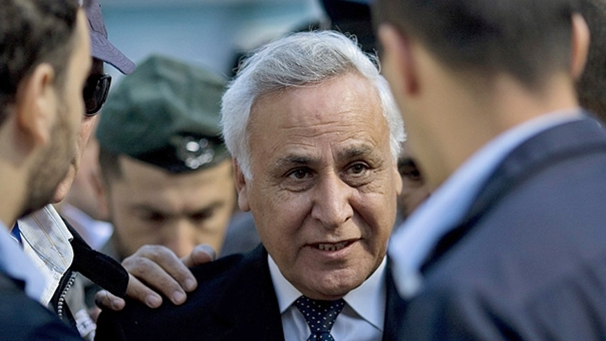 March 22: Former Israeli President Moshe Katsav, center, arrives at a court in Tel Aviv.