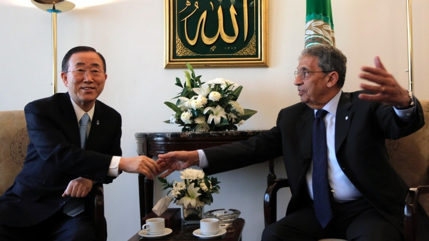 March 21: UN Secretary-General Ban Ki-moon, left, shakes hands with Arab League chief Amr Moussa during a meeting at the Arab League headquarters in Cairo, Egypt. A group of protesters angry about international intervention in Libya blocked the path of U.N. Secretary-General Ban Ki-Moon as he left a meeting at the Arab League.