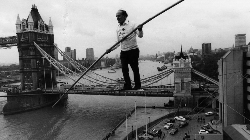 November 23, 1976: Karl Wallenda walking a tightrope from two corners of the Tower Hotel with Tower Bridge in the background. (Photo by Evening Standard/Getty Images)