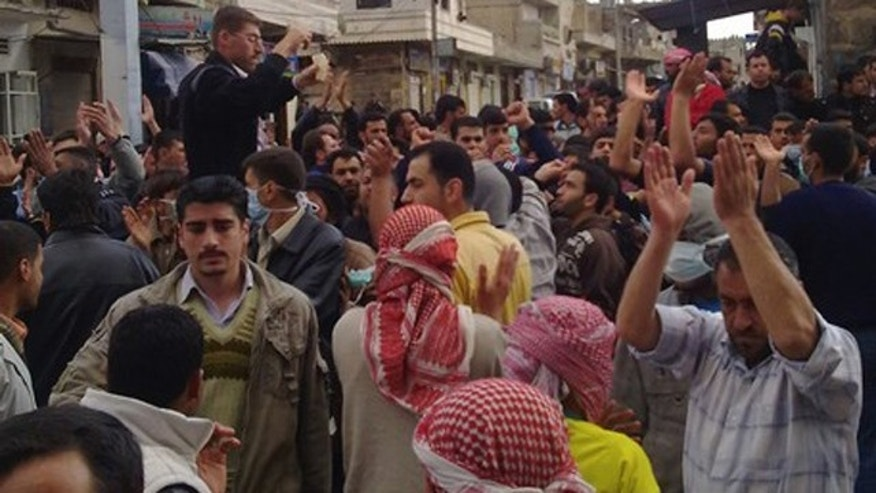 March 22: Protesters gather near the Omari Mosque in the southern old city of Deraa in this picture taken with a mobile phone.