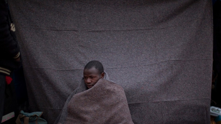March 20: A man from Ghana, who used to work in Libya and fled the unrest in the country, is seen next to his makeshift shelter after spending the night in a refugee camp at the Tunisia-Libyan border, in Ras Ajdir, Tunisia.