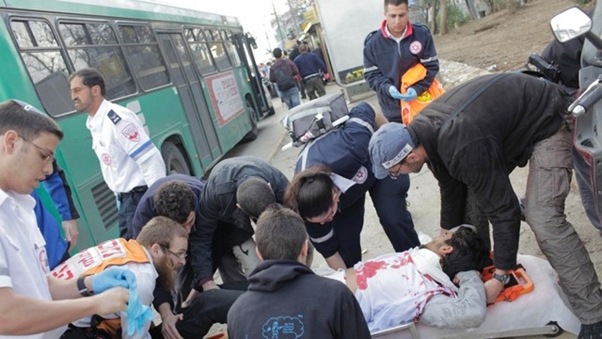 March 23: Israel rescue workers and paramedics treat an injured man after an explosion near a bus stop in Jerusalem.