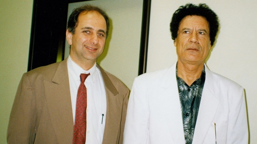 In this photo released by plastic surgeon Fabio Naccache on Thursday March 24, 2011, Libyan leader Moammar Gadhafi, right, and Brazilian plastic surgeon Dr. Fabio Naccache pose for a photo in Tripoli, Libya in 1994.  Sao Paulo-based plastic surgeon Dr. Fabio Naccache confirmed to the Associated Press that he was part of the team and performed a hair transplant procedure on the Libyan leader 16 years ago. (AP Photo/Fabio Naccache)