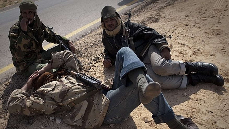 March 24: Libyan rebels take a rest on a checkpoint on the frontline near Zwitina, the outskirts of the city of Ajdabiya, south of Benghazi, eastern Libya.