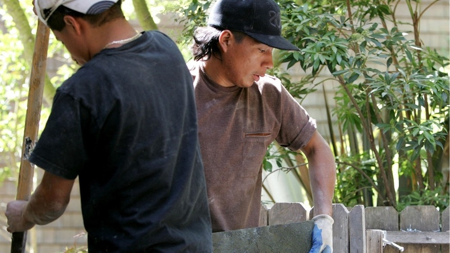 SAN RAFAEL, CA - MAY 23:  Illegal immigrant Jose Augustine (R) of Guatemala carries a slab of stone  while working on a landscaping job May 23, 2007 in San Rafael, California. Jose came to the United States from Guatemala and is currently living and working as a landscaper in Marin County, California. Jose is married with one child who still lives in Guatemala. The Senate immigration bill currently being debated in Washington would lay out a scenario for Jose and his family to become citizens, which could include paying a fine and returning to ones country of origin.  (Photo by Justin Sullivan/Getty Images)